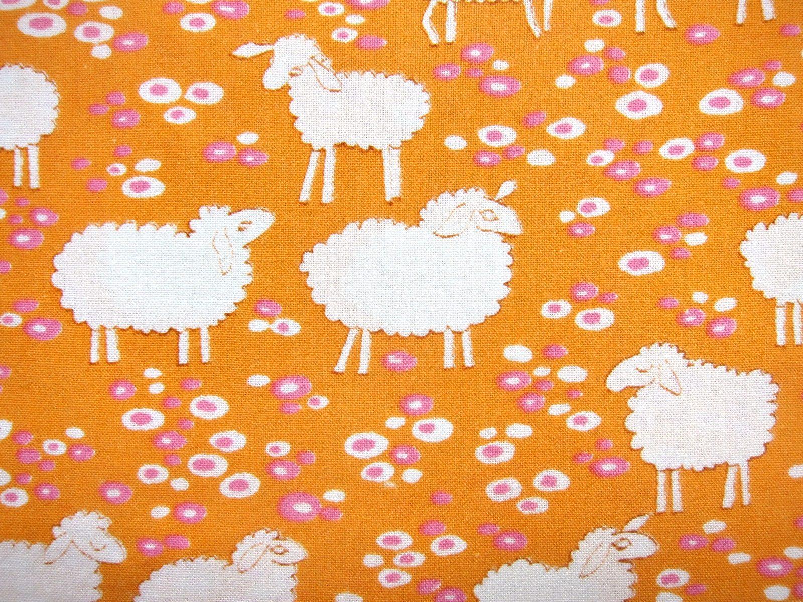 羊のイラスト オレンジ色の動物柄ヴィンテージ生地 幅94cm